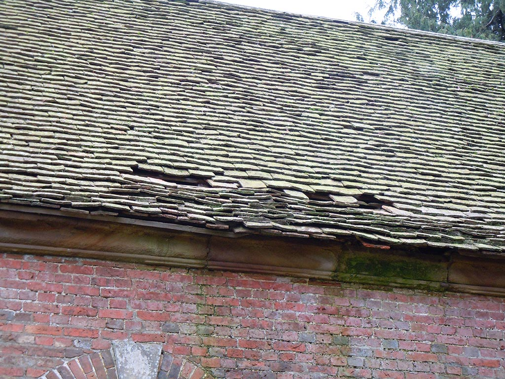 Damp-to-masonry-and-damaged-tiles